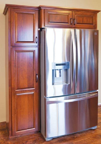 custom built refridgerator surround by jewel cabinet refacing